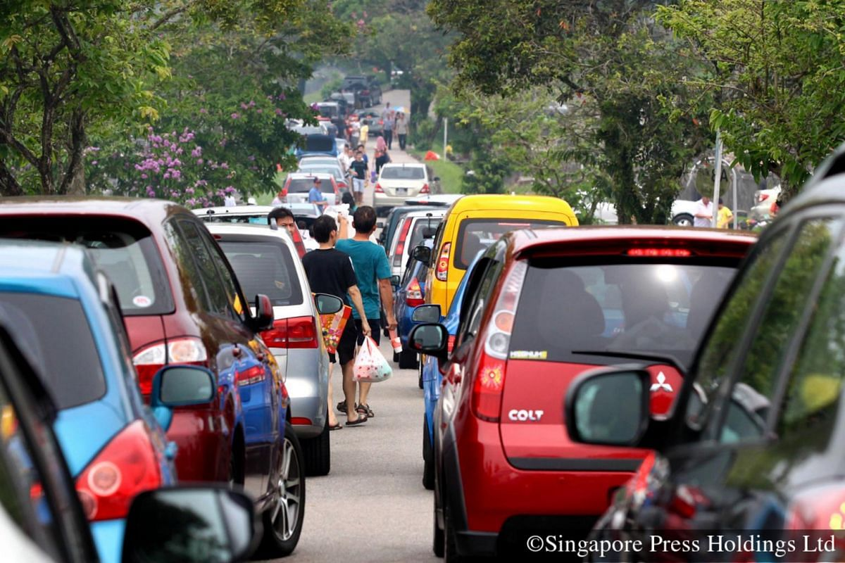 2013: A common sight now as it was then, where vehicles packed the narrow lanes at the Choa Chu Kang cemetery.