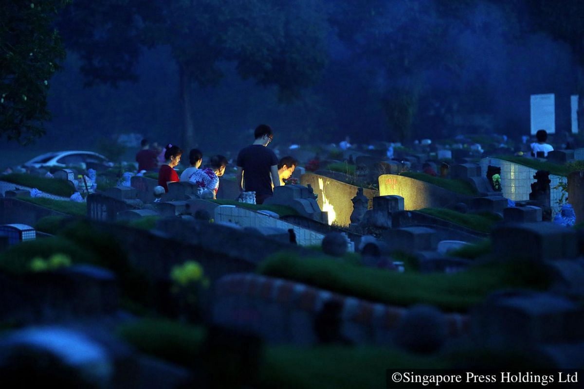 2015: It is just before the break of dawn and many families are already praying at the Choa Chu Kang Cemetery.