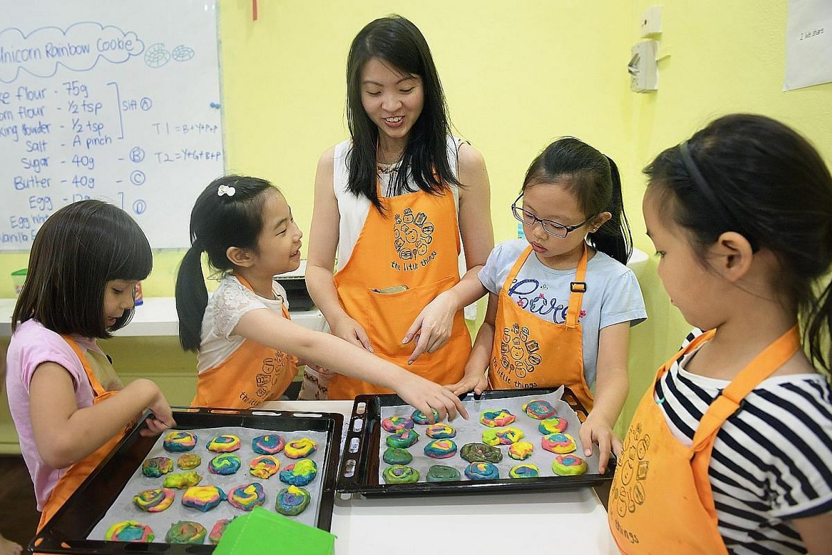 The Little Things' teacher Valerie Lee with (from left) Nadia Siyu Bres, six, Dorsher Ng, eight, Giselle Ng, nine, and Chloe Teo, seven. Palate Sensations Cooking School has a variety of kids' programmes.