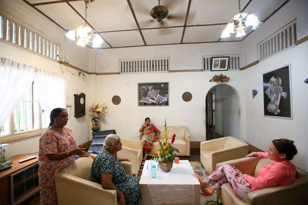 The living room of Lakshmi Villa, with a portrait of Mr Doraisamy Kuppusamy and his wife Lakshmi hanging above the entrance to a corridor leading into the house.