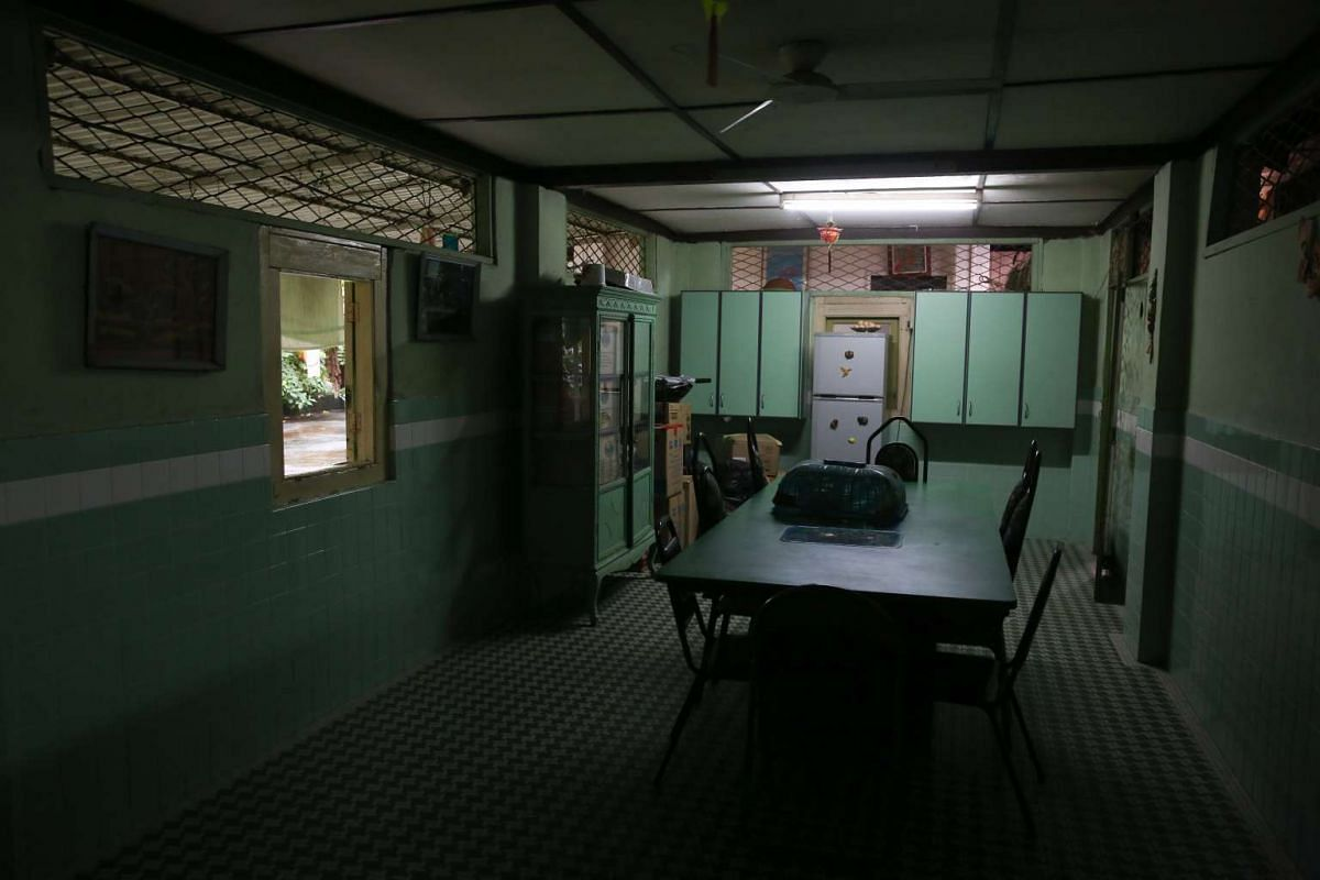 A disused dining room at the back of Lakshmi Villa.The dining table had been specially designed by Indonesian craftsmen, but began to be used less frequently as members of the Kuppusamy family moved out.