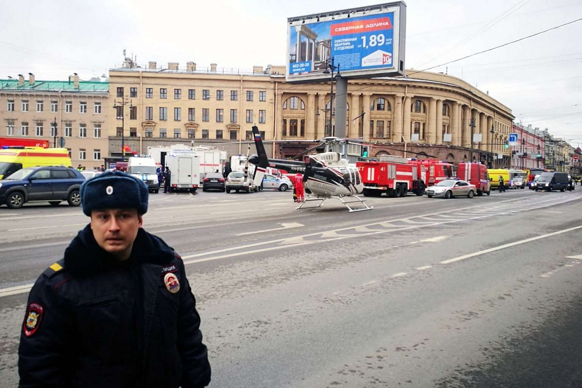 Emergency vehicles and a helicopter are seen at the entrance to the Technological Institute metro station in St Petersburg on April 3, 2017.