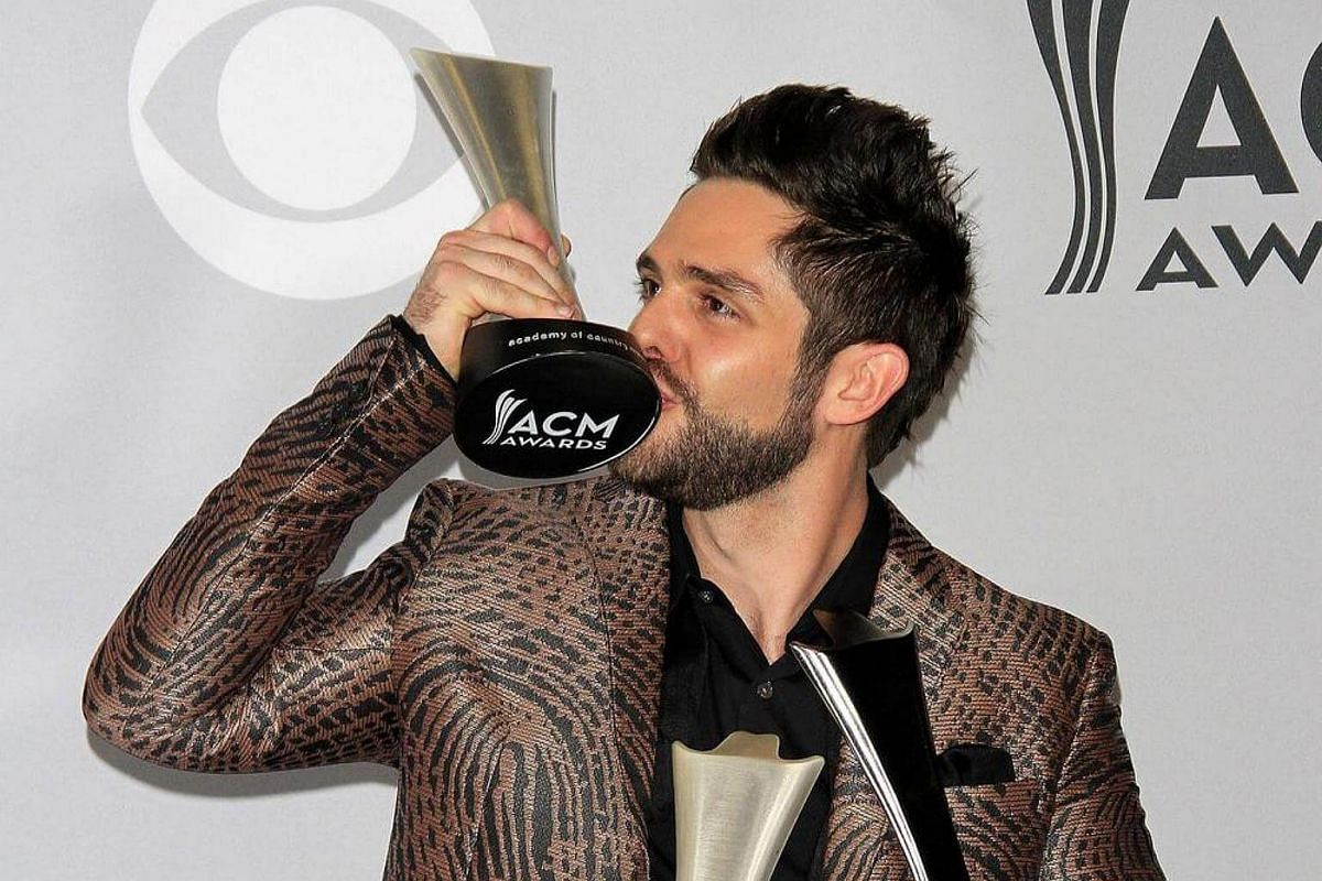 Singer-songwriter Thomas Rhett, winner of the awards for Male Vocalist Of The Year and Song Of The Year, poses in the press room.