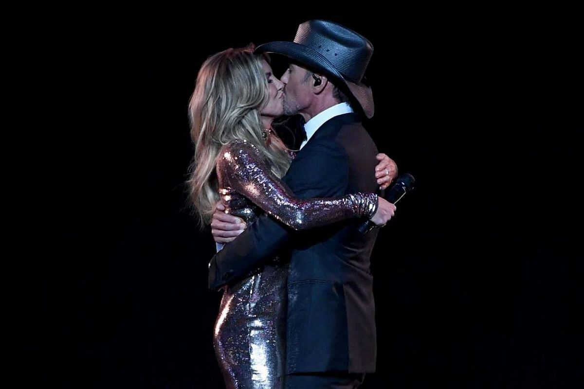 Country music couple Faith Hill and Tim McGraw kiss after performing together during the 52nd Academy of Country Music Awards at T-Mobile Arena in Las Vegas, Nevada.