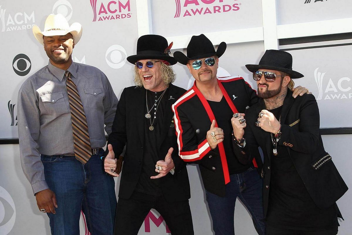 Recording artists (from left) Cowboy Troy, Big Kenny and John Rich of music group Big & Rich, and DJ Sinister pose as they arrive for the 52nd Academy of Country Music Awards.