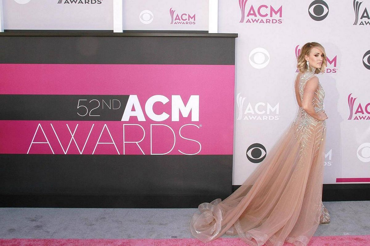 Singer Carrie Underwood arrives for the 52nd Academy of Country Music Awards.