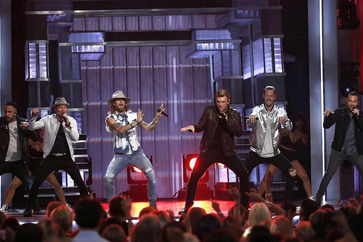 Florida Georgia Line and the Backstreet Boys perform God, Your Mama And Me during the awards ceremony.