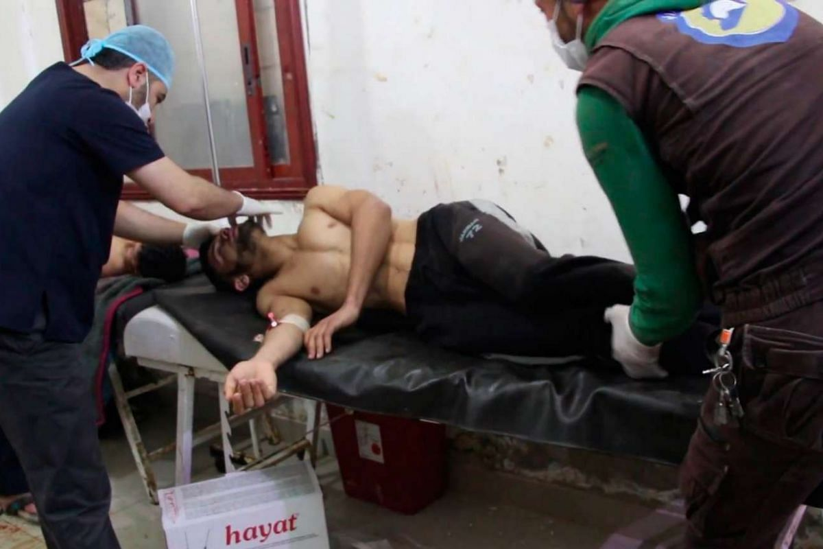 Syrian people receiving treatment after an alleged chemical attack at a field hospital in Saraqib.