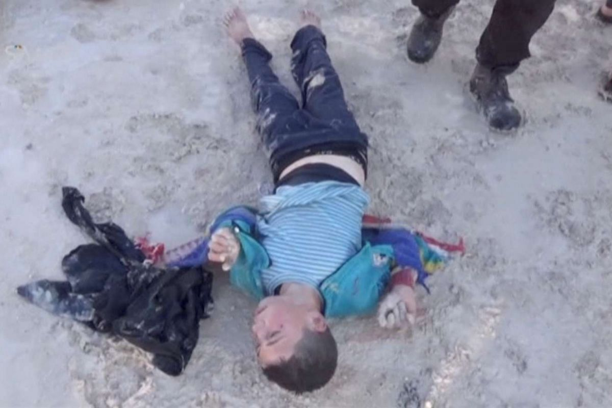 A still image taken from a video shows a boy lying on the ground said to be in the town of Khan Sheikhoun.