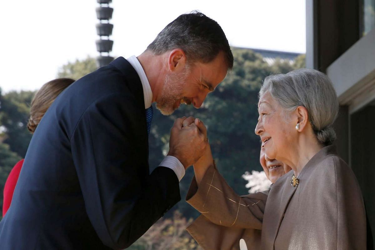 Spain's King Felipe greeting Japan's Empress Michiko upon his arrival for a welcoming ceremony at the Imperial Palace in Tokyo on April 5, 2017.