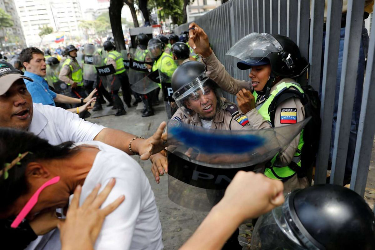 Demonstrators scuffling with security forces during an opposition rally in Caracas, Venezuela, on April 4, 2017.