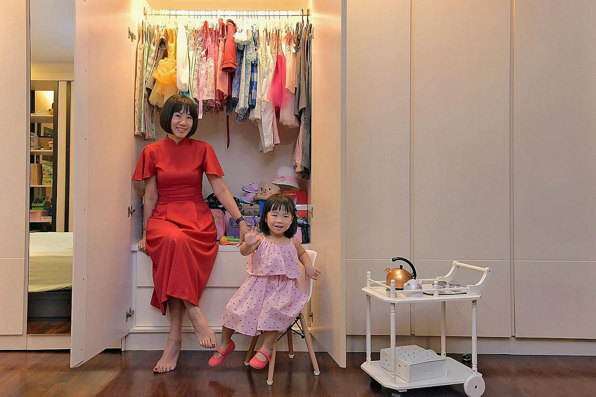 Sea Apple founder Ho Su Mei (above) says more shoppers here are starting to appreciate made-in- Singapore brands for their original designs. Ms Joanne Sim (right) buys her daughter, Sophie, 21/2, outfits from home-grown children's fashion brands as s