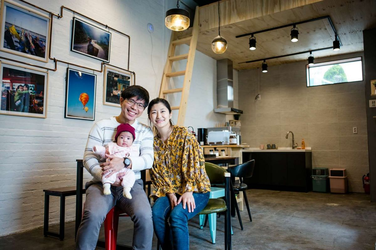 Mr Glynsen Wong with his wife, Yiseul, and their three-month-old daughter in their guesthouse in Busan.