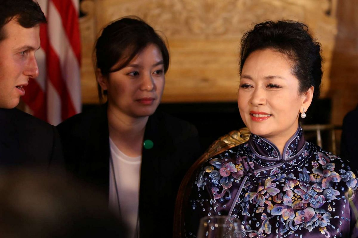 China's First Lady Peng Liyuan (right) with Trump senior adviser Jared Kushner (left) as they attend a dinner at the start of a summit between US President Donald Trump and Chinese President Xi Jinping at Mar-a-Lago estate in West Palm Beach, on Apri