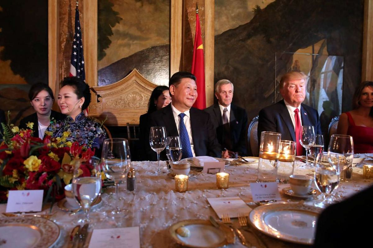 Chinese President Xi Jinping and US President Donald Trump attending a dinner accompanied by First Ladies Peng Liyuan (second, left) and Melania Trump (right) at Mr Trump's Mar-a-Lago estate in West Palm Beach, Florida, US, on April 6, 2017.