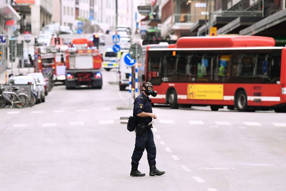 A police officer at the scene of the truck crash.