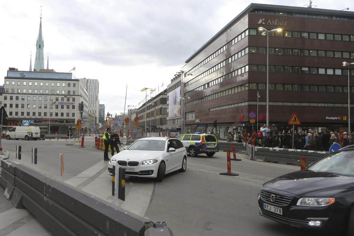 Police officers guard near the department store in central Stockholm.