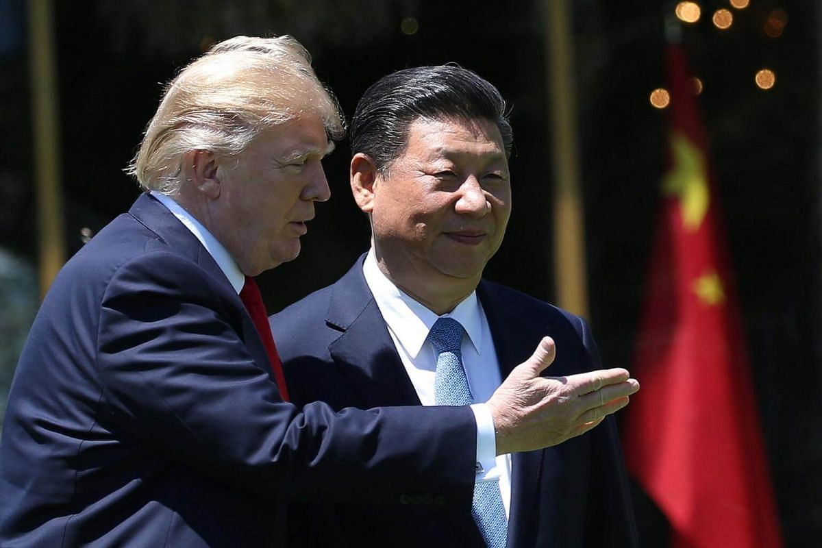 US President Donald Trump and China's President Xi Jinping chat as they walk along the front patio of the Mar-a-Lago estate after a bilateral meeting in Palm Beach, Florida, US, on April 7, 2017.