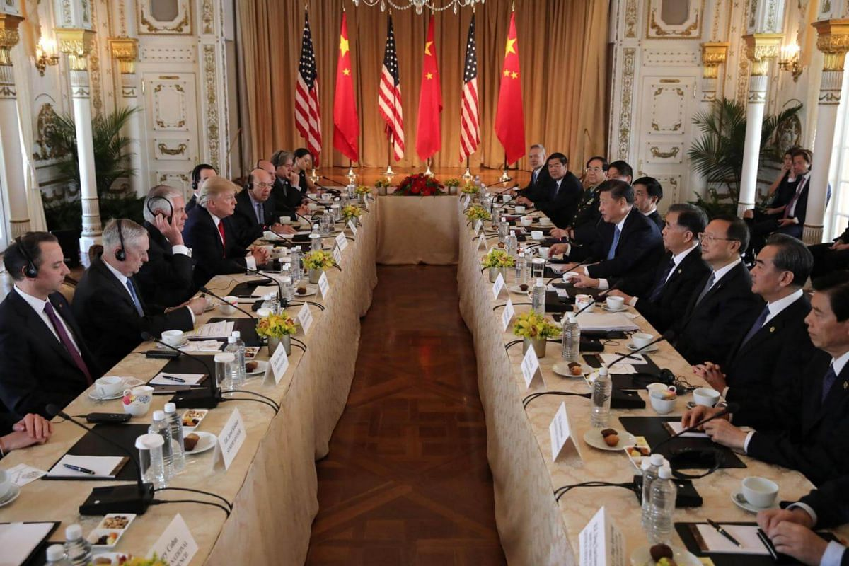 US President Donald Trump (fourth from left) holds a bilateral meeting with China's President Xi Jinping (fifth from right) at Trump's Mar-a-Lago estate in Palm Beach, Florida, US, on April 7, 2017.