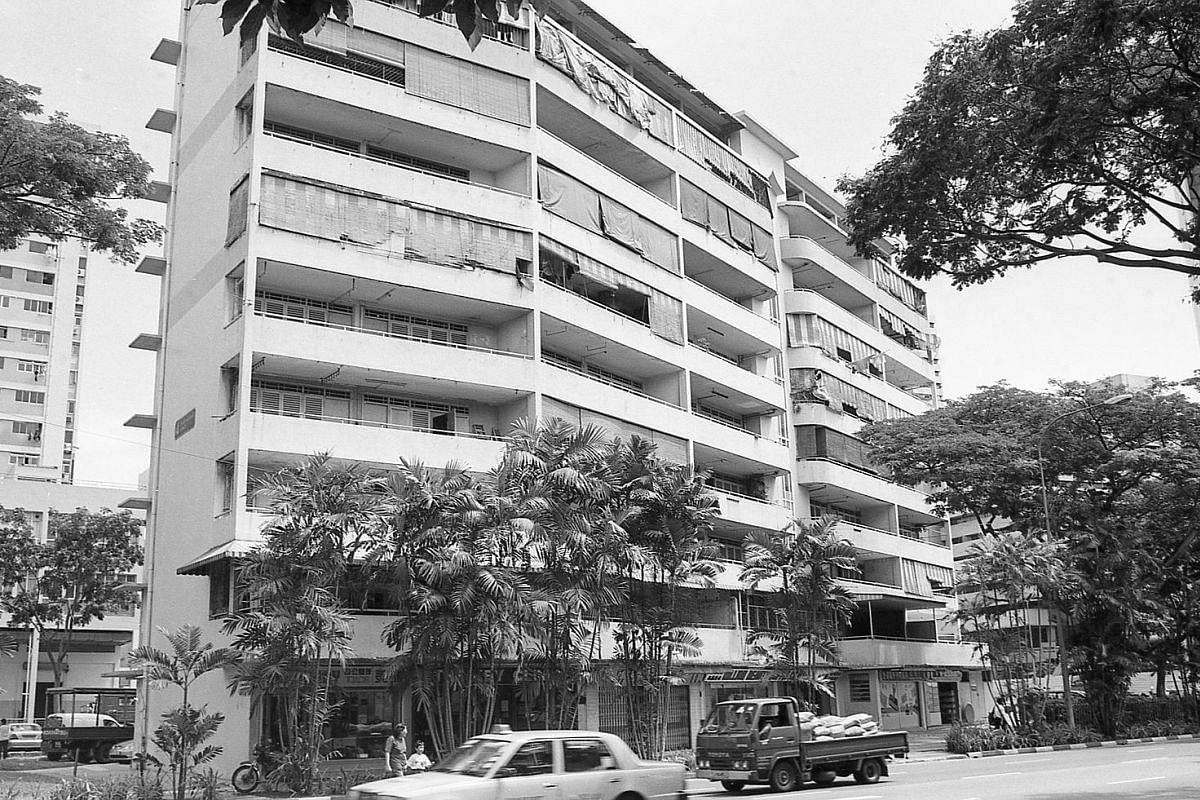 This public housing block at Upper Pickering Street (above) has been torn down, but was captured on film by hobbyist photographer Koh Kim Chay.