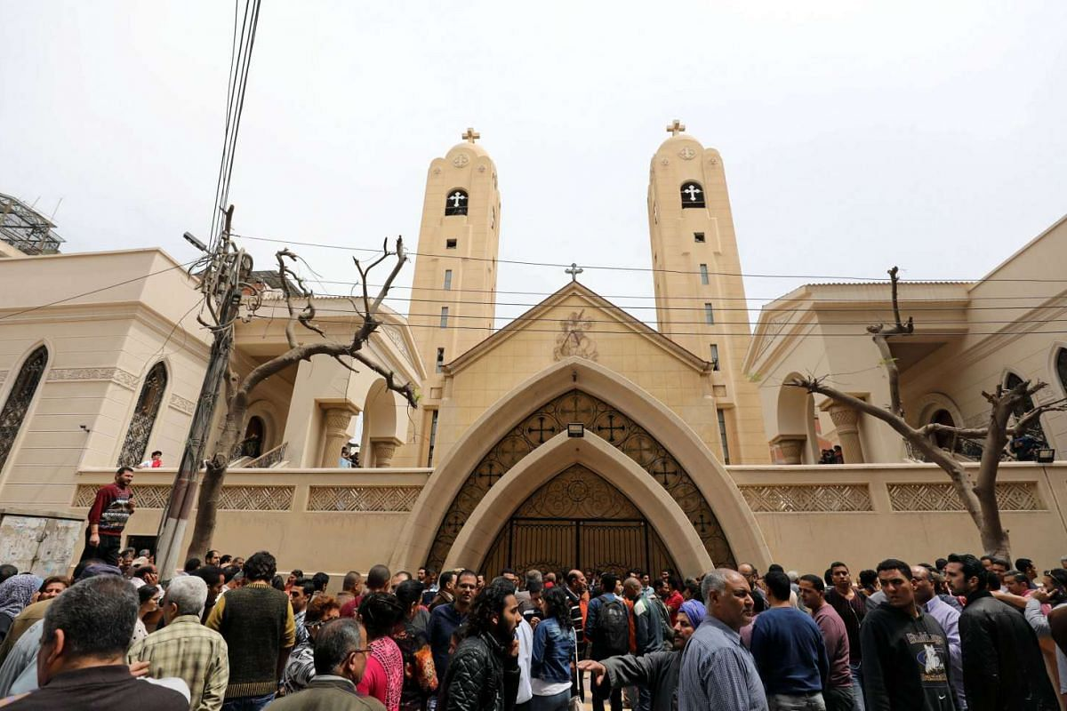 Crowds gather outside the church after the attack.