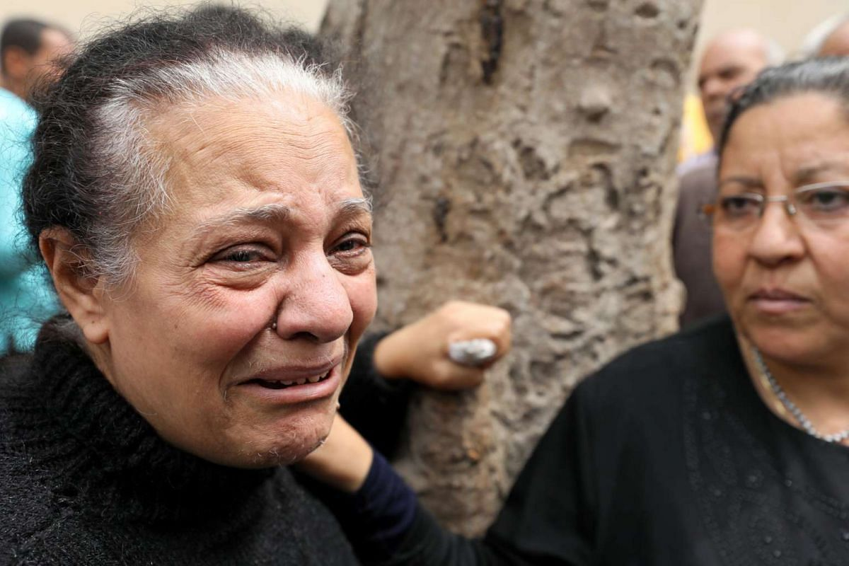A woman mourns her relative killed in the explosion.