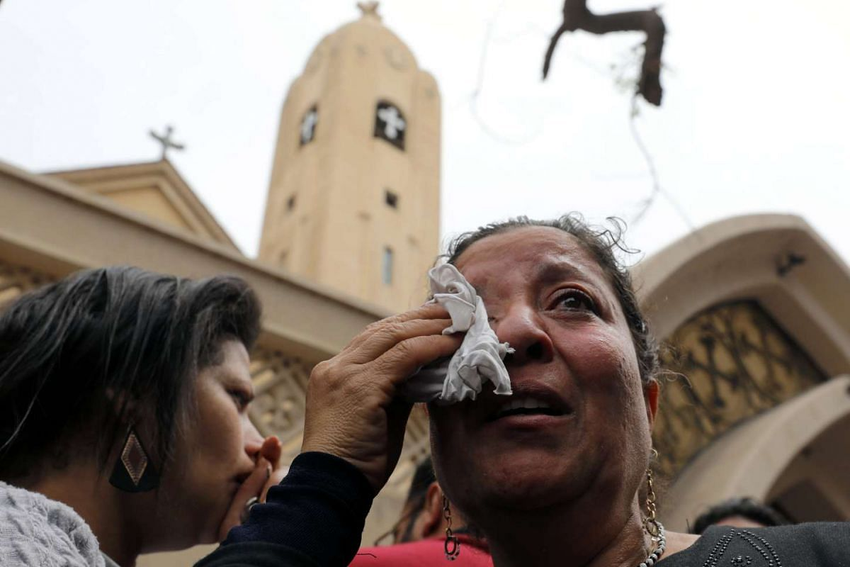 A relative of one of the victims is in tears at the scene of the explosion.