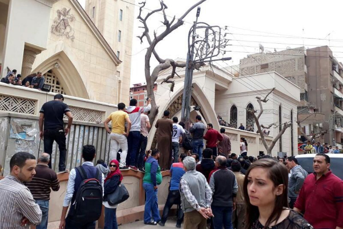People gather in front of the church after the explosion.