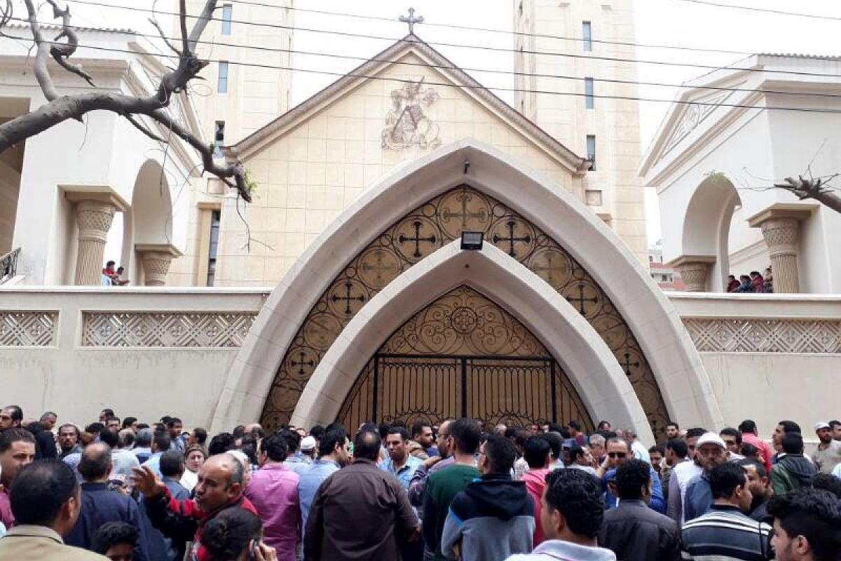 People gather outside the church after the explosion.