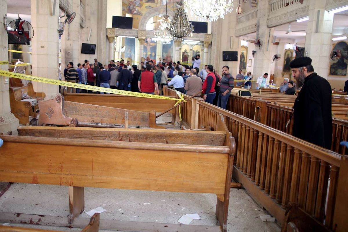 A Coptic priest looks at the damage in the church.