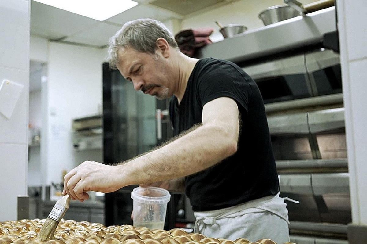French pastry chef Frederic Deshayes making hot cross buns.
