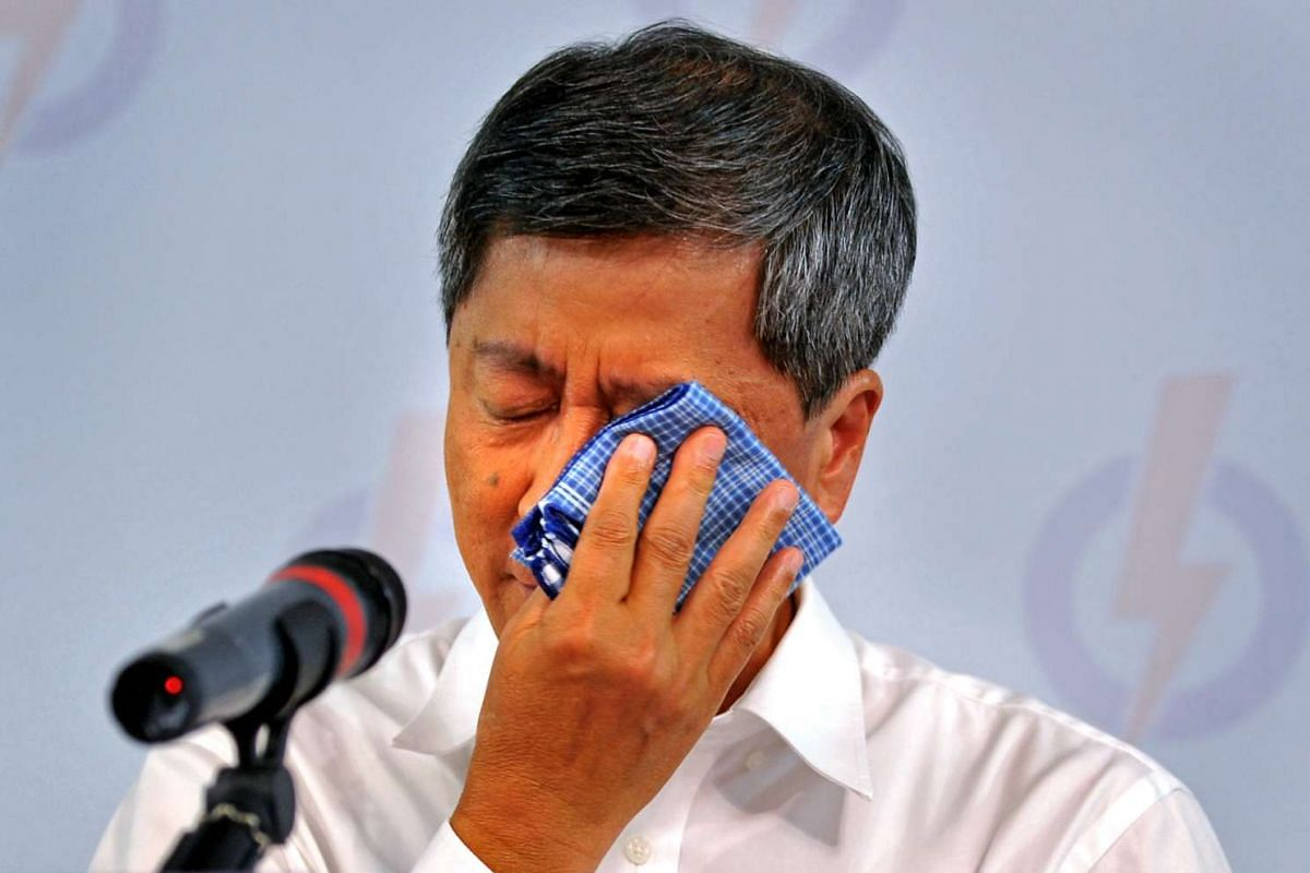 Let it flow: Mr Lim Boon Heng at a press conference during the general election in 2011.