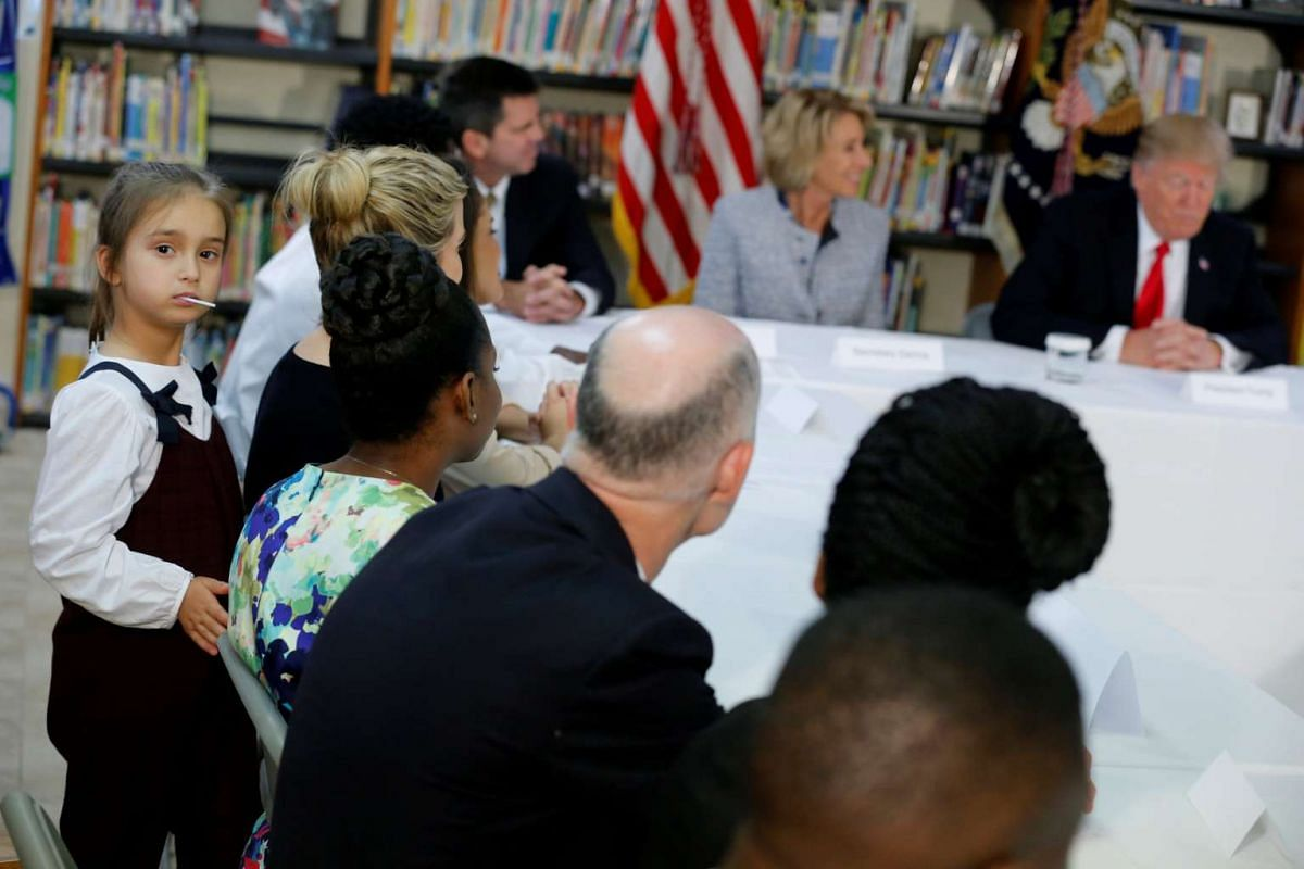 US President Donald Trump's granddaughter Arabella Kushner (left) joins her mother Ivanka Trump and Mr Trump as he meets with parents and teachers at Saint Andrew Catholic School in Orlando, Florida, on March 3.