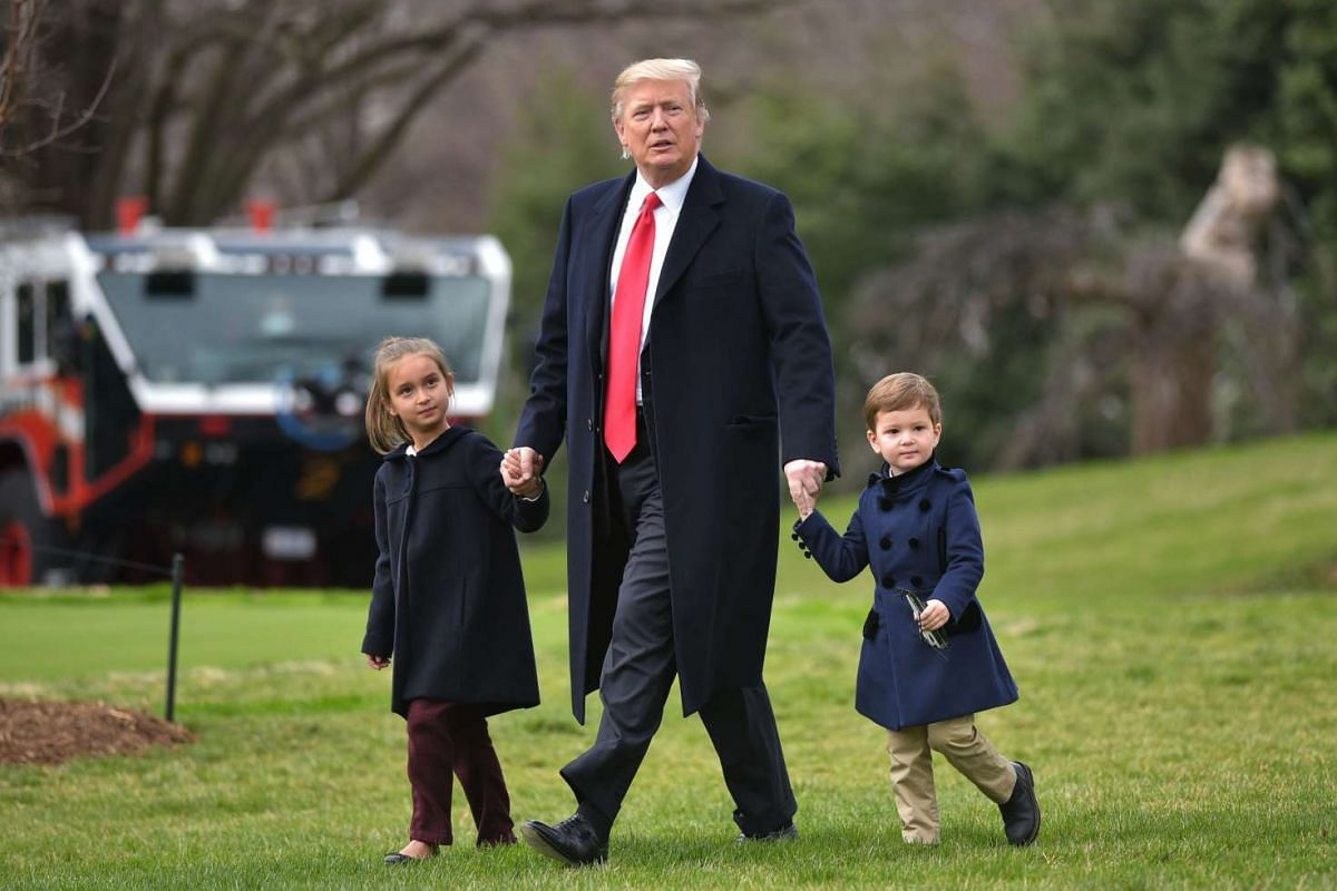 US President Donald Trump makes his way to board Marine One with grandchildren Arabella Kushner (left) and Joseph Kushner, from the White House in Washington, DC, on March 3, 2017.