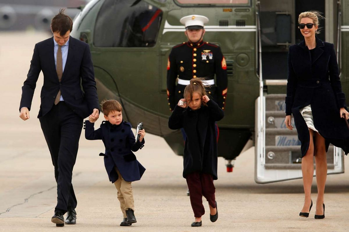 US President Donald Trump's daughter Ivanka Trump (right) and her husband Jared Kushner and children Joseph and Arabella Kushner, arrive aboard the Marine One helicopter with the president to board Air Force One for travel to Florida from Joint Base