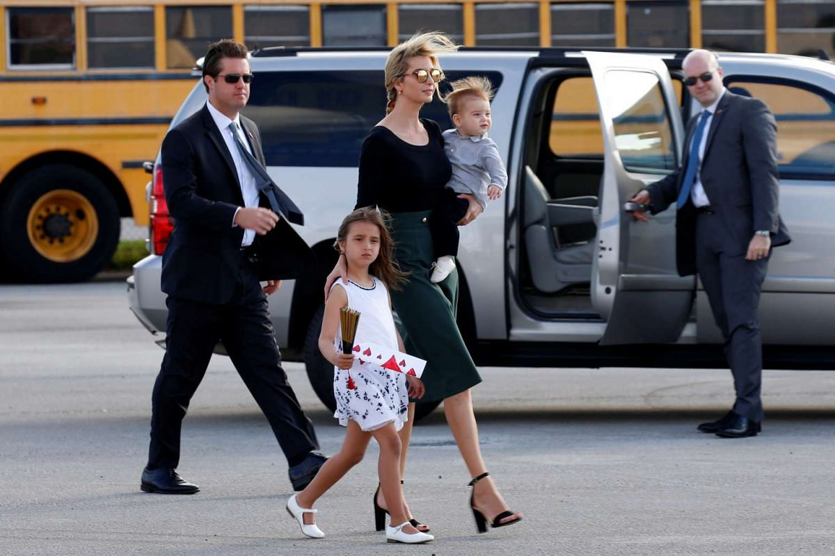 Ivanka Trump walks with her children Arabella and Theodore as they board Air Force One to depart West Palm Beach, Florida, on February 20, 2017.