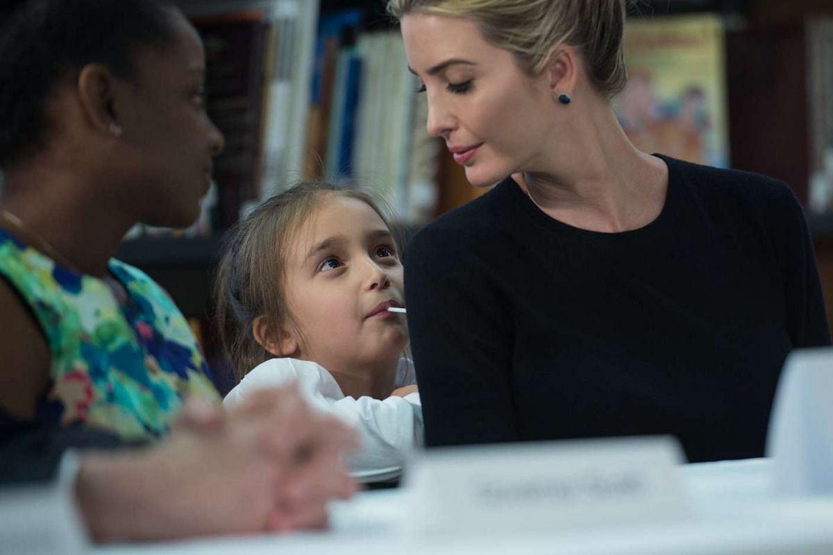 Ivanka Trump looks at her daughter Arabella as US President Donald Trump meets with parents and teachers at Saint Andrew Catholic School in Orlando, Florida, on March 3, 2017.