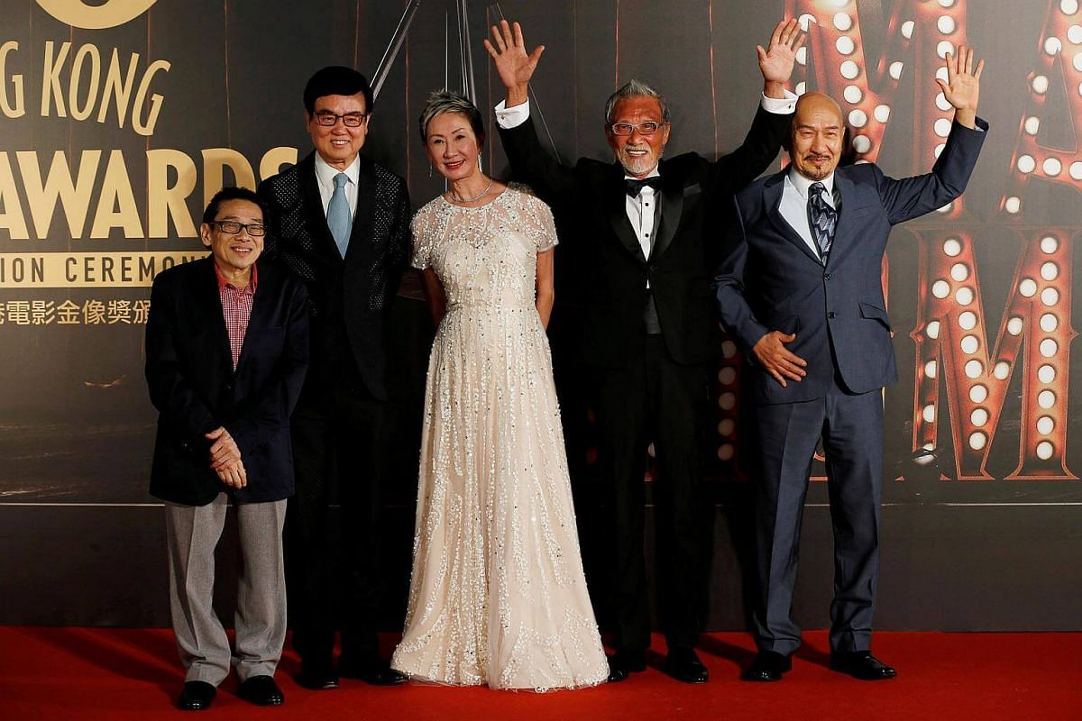 From left: Actor Teddy Robin, director Raymond Wong, producer Shi Nansun, director Dean Shek and actor Karl Maka pose on the red carpet at the Hong Kong Film Awards on April 9, 2017.