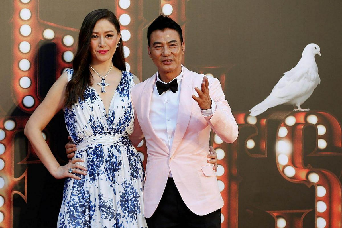 Actor Simon Yam and his wife Sophia Kao, better known as Qi Qi, pose on the red carpet at the Hong Kong Film Awards on April 9, 2017.