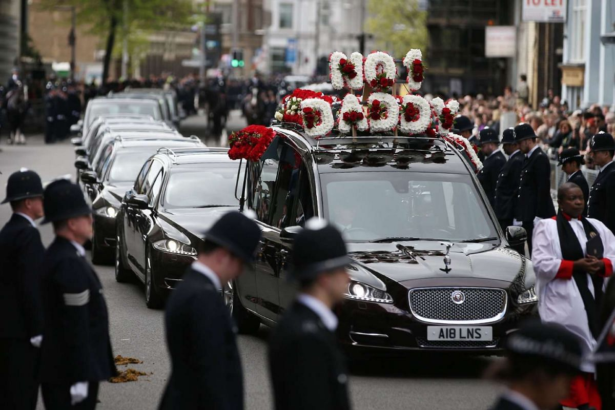Police officers line the route as the hearse carrying the coffin of PC Keith Palmer, the officer killed in the March 22 Westminster terror attack, arrives at Southwark Cathedral in London on April 10, 2017. PHOTO: AFP/POOL