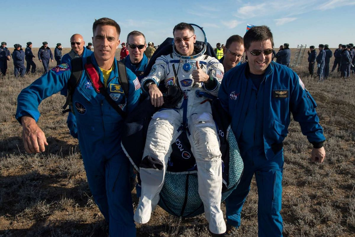 Ground personnel carry International Space Station (ISS) crew member and NASA astronaut Shane Kimbrough shortly after the landing of Russia's Soyuz MS-02 space capsule near the town of Dzhezkazgan (Zhezkazgan), Kazakhstan, April 10, 2017. PHOTO: REUT