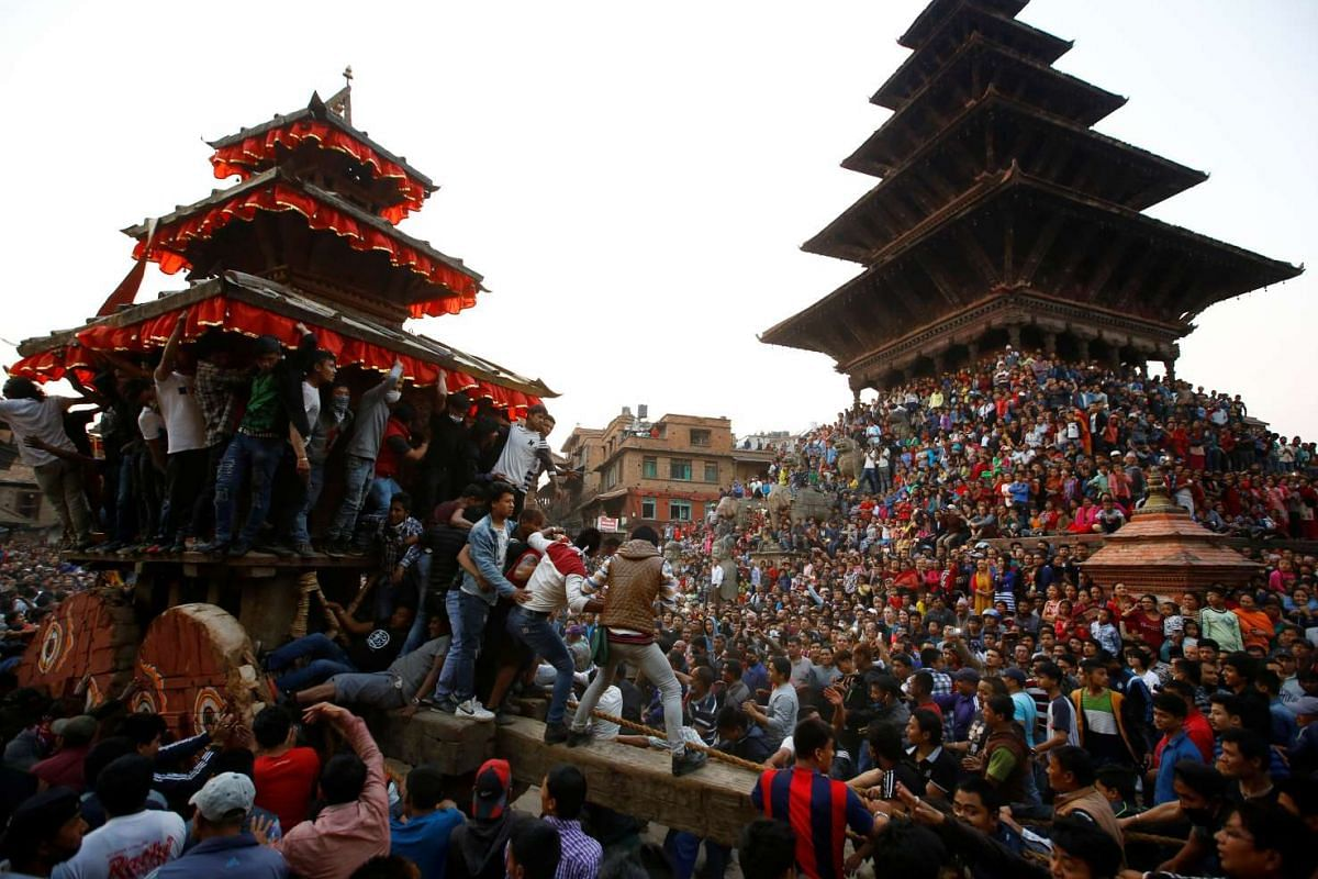 Devotees pull the chariot of God Bhairab during the Biska Festival also known as Bisket festival in Bhaktapur, Nepal April 10, 2017. PHOTO: REUTERS
