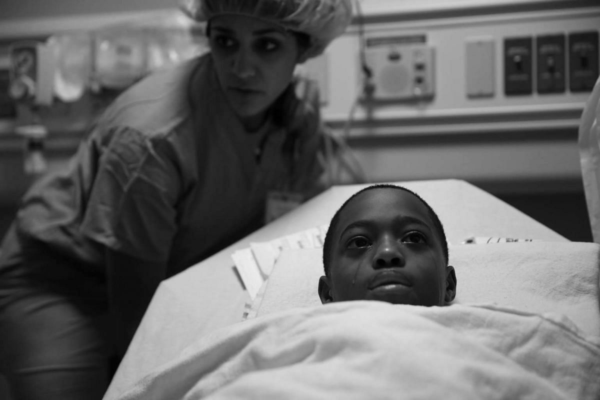 A handout photo of Tavon Tanner, before undergoing surgery at Lurie Children's Hospital in Chicago to remove the bullet, on April 10, 2017.