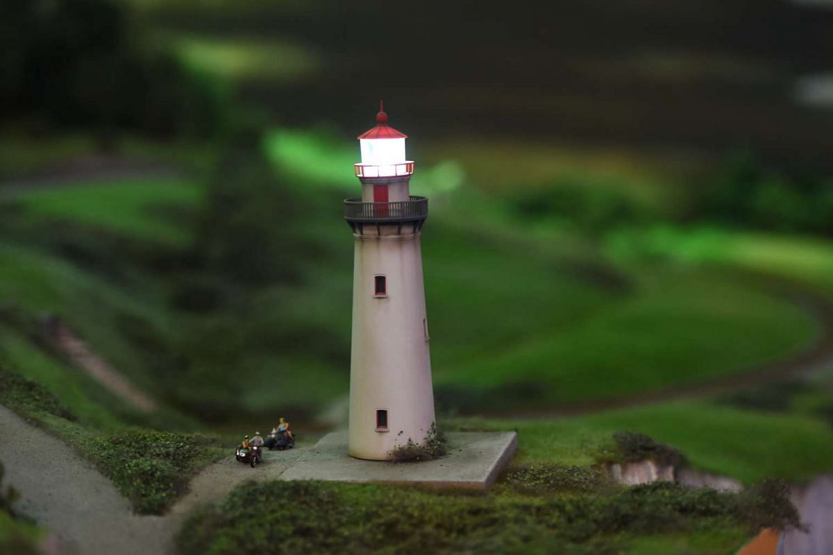 A miniature model of a lighthouse in a United Kingdom countryside.