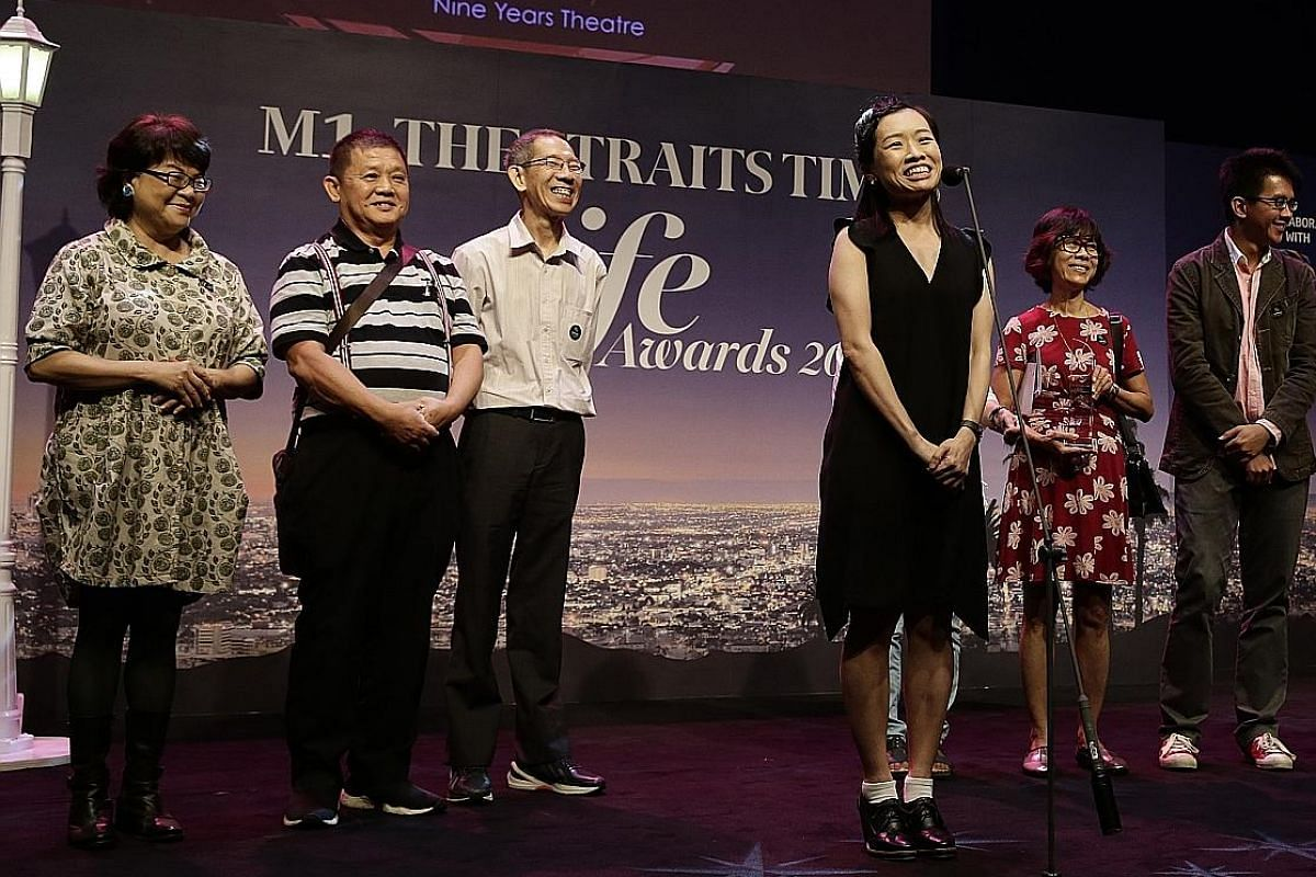 The cast and crew of Red Sky by Nine Years Theatre, led by producer Mia Chee, receiving the award for Best Ensemble.