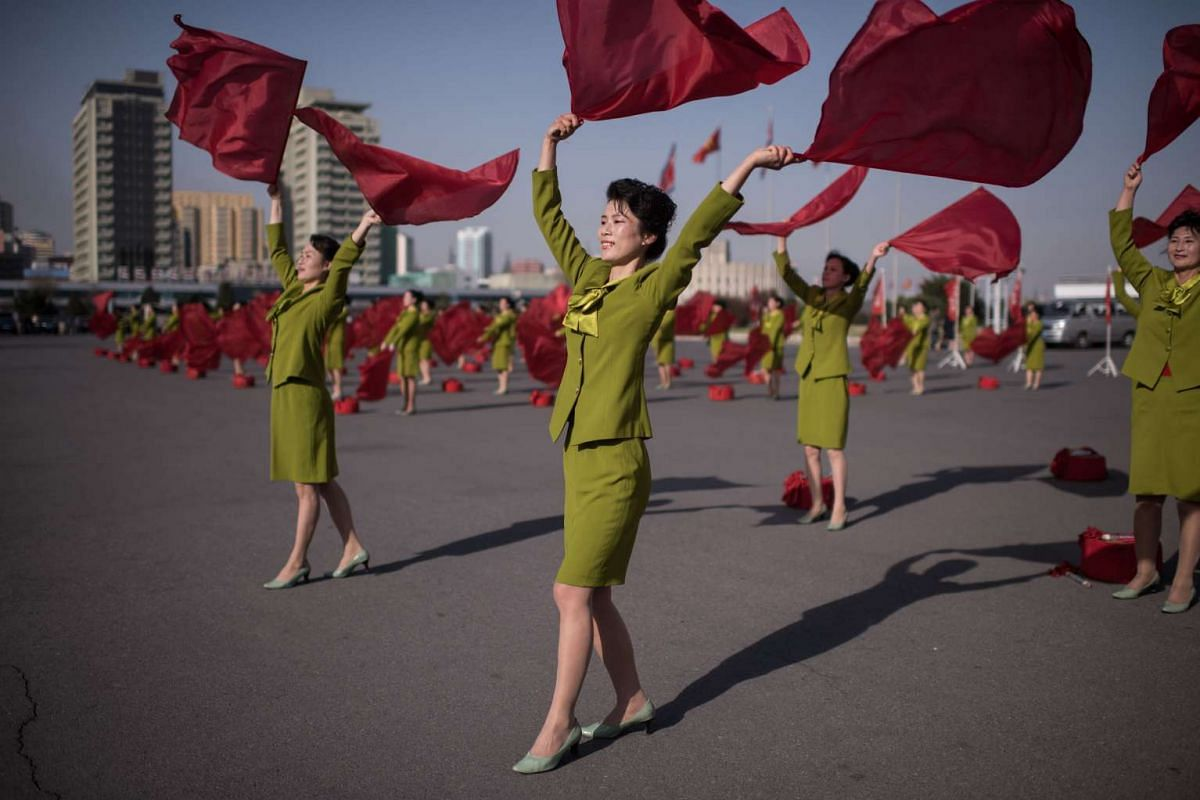 Members of a propaganda troupe perform in a public square in Pyongyang on April 12, 2017. PHOTO: AFP