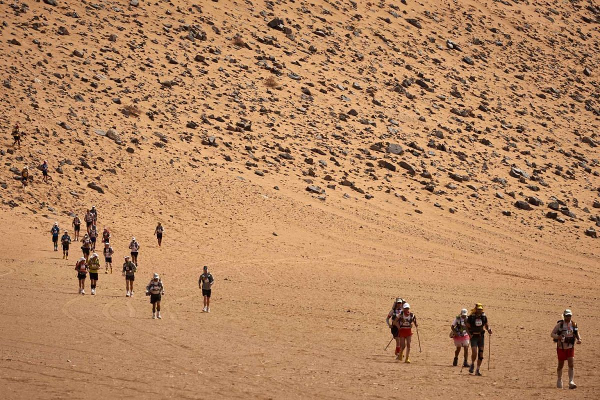 Competitors take part in the 4th Stage of the 32nd edition of the Marathon des Sables between Nord El Maharch and Jebel El Mraier in the southern Moroccan Sahara desert on April 12, 2017. PHOTO: AFP