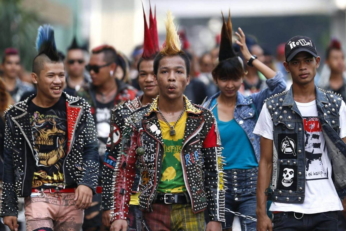 A group of around 60 punks walk to downtown Yangon for a punk gathering ahead of the Thingyan water festival.