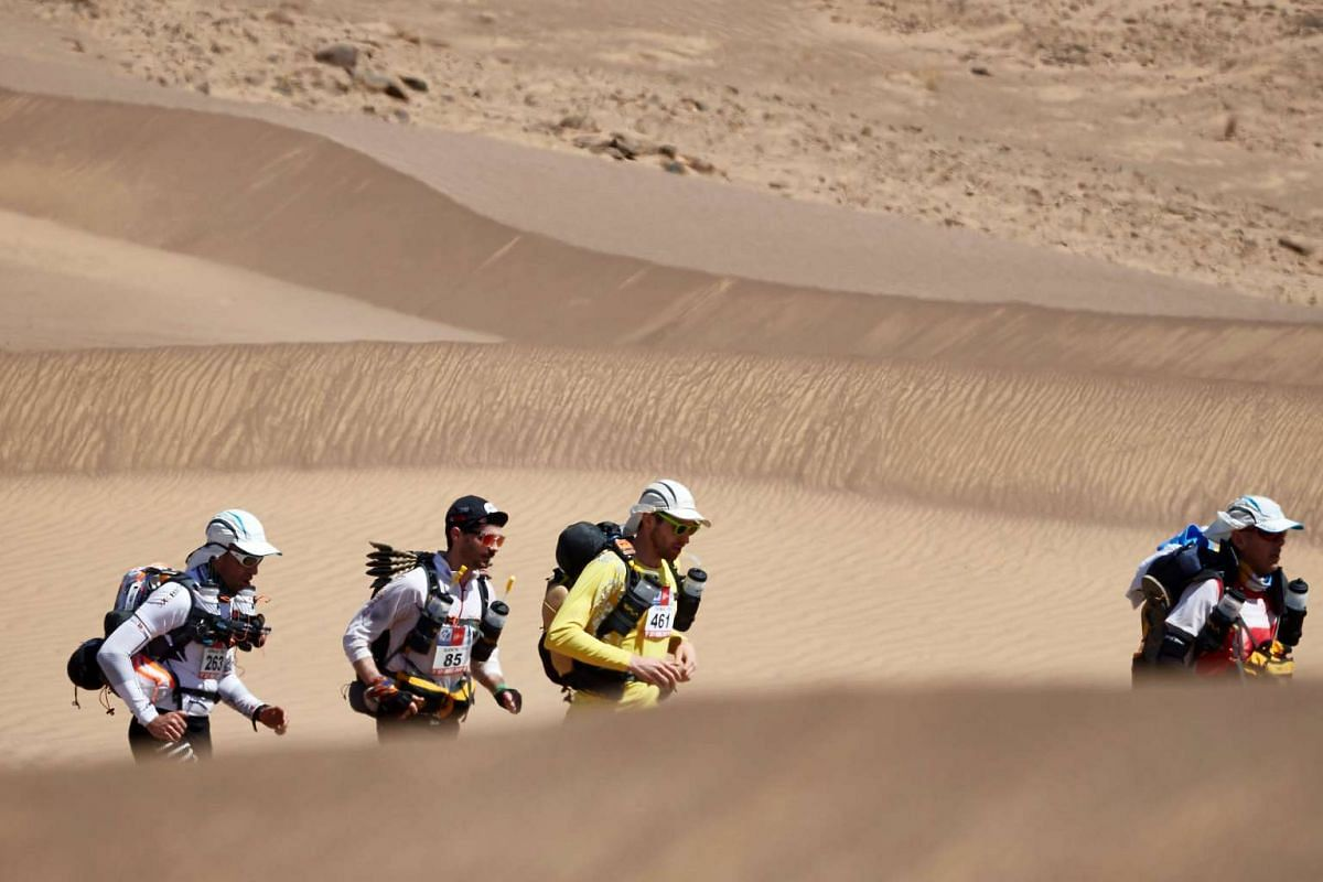 Competitors take part in Stage 1 of the 31st edition of the Marathon des Sables between Timgaline and Ouest Aguenoun N'Oumerhiout in the southern Moroccan Sahara desert on April 9, 2017.