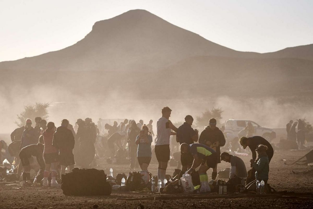 Competitors prepare for Stage 1 of the 31st edition of the Marathon des Sables between Timgaline and Ouest Aguenoun N'Oumerhiout in the southern Moroccan Sahara desert on April 9, 2017.